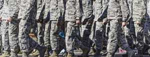 military personnel walking in formation