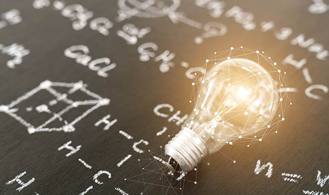 A graphic of a lightbulb over a paper schematic