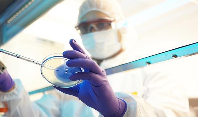 Photo: Drug researcher testing a sample