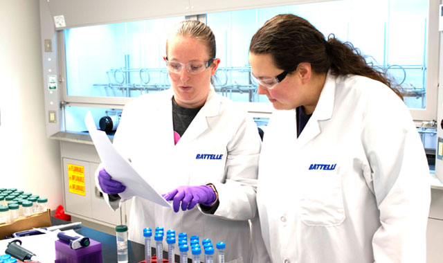 Photo: PFAS Accredited Lab with two women PFAS experts reviewing PFOA analysis report