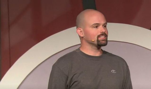 Chris Domas on stage presenting during an event