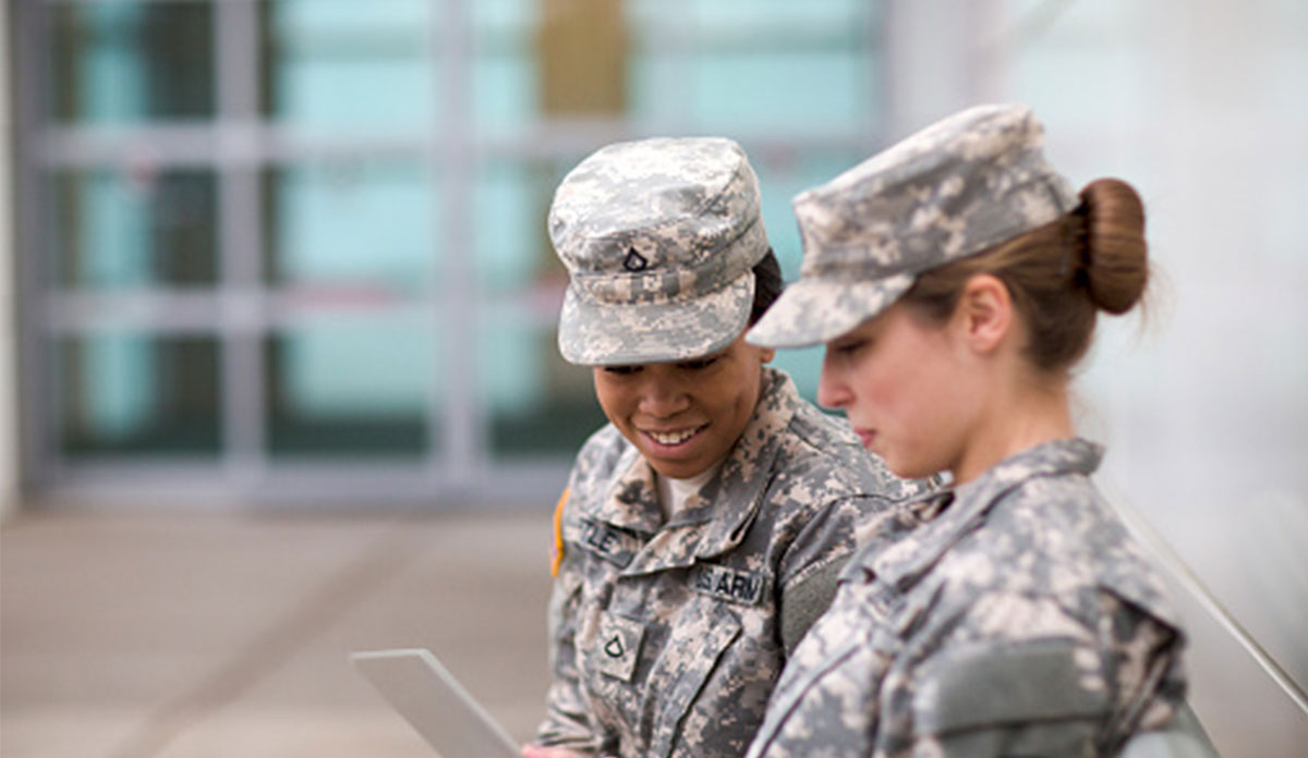 Photo: Two women in the military looking at a tablet