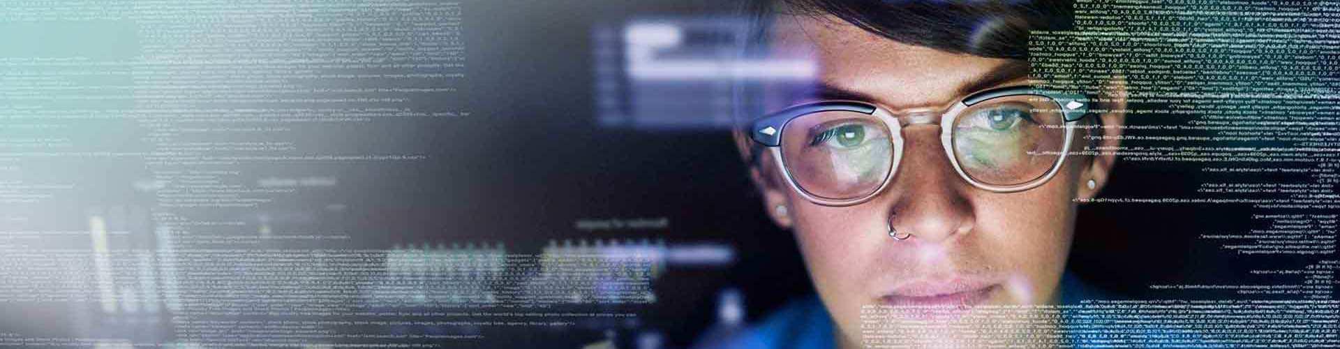 Female sitting behind computer.