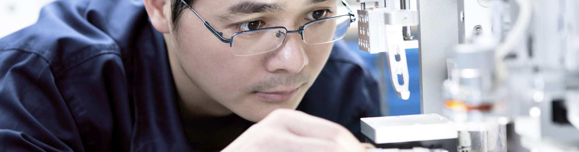 Male technician working in factory.