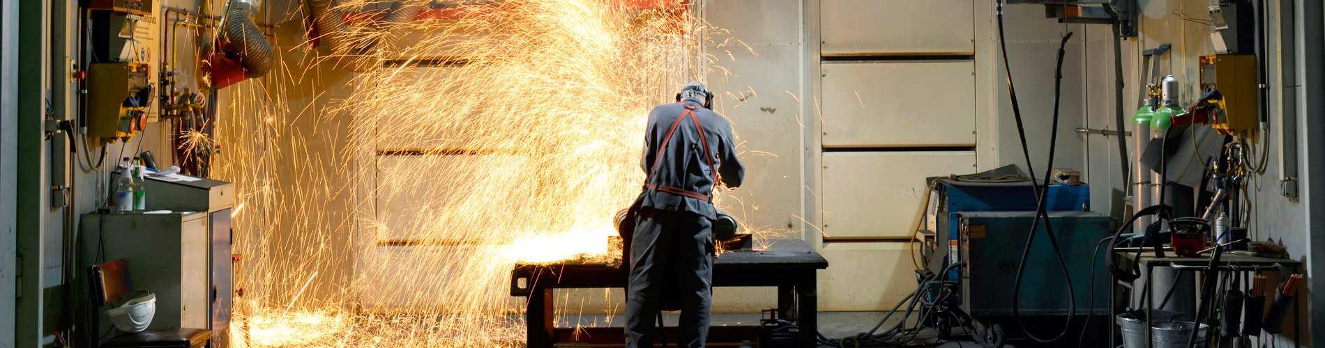 Man welding in garage.
