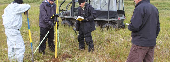 Researchers taking samples at a site in Alaska