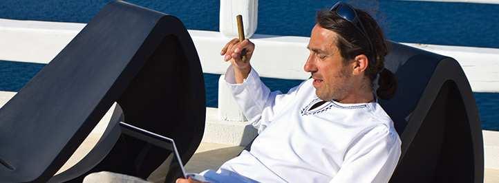 Man sitting in chair smoking cigar