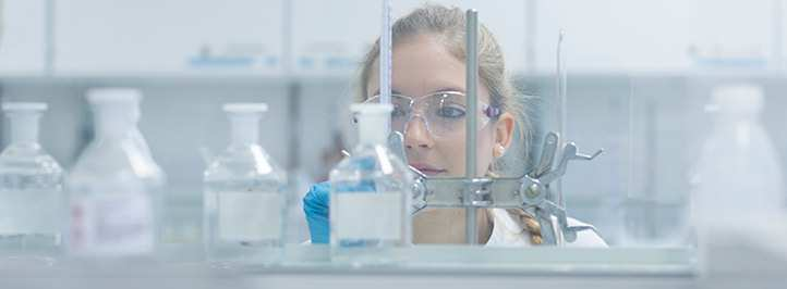 Female researcher working in lab.