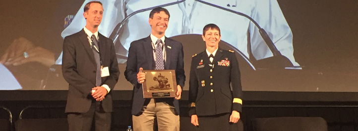 Battelle's Erik Edwards receives award from the Military Health System Research Symposium