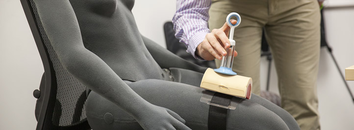 researcher testing a med device on a dummy