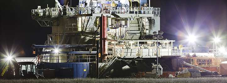 Oil drilling site at night