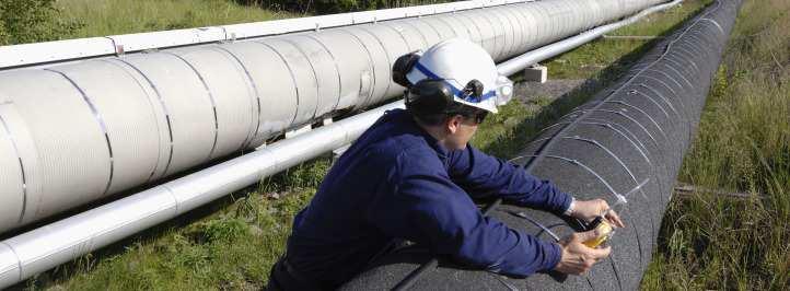 Technician working on oil pipeline